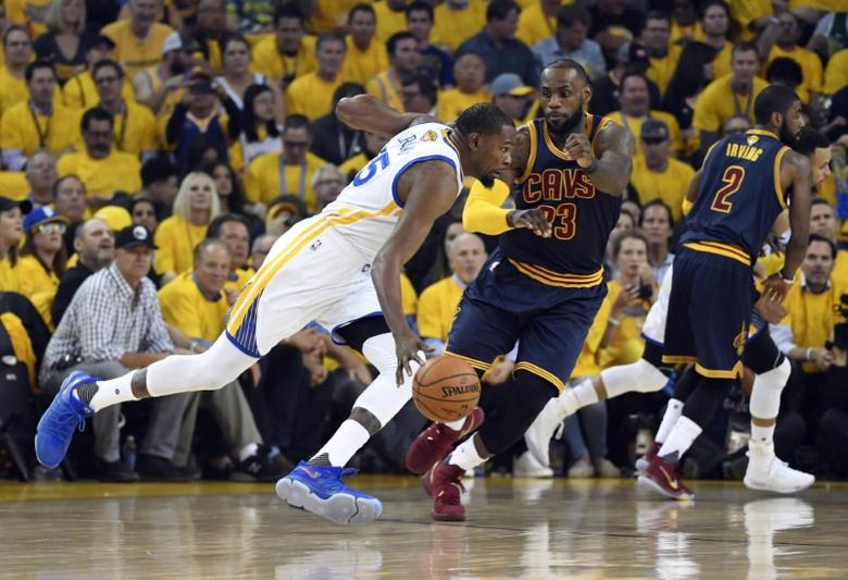 Jun 1, 2017; Oakland, CA, USA; Golden State Warriors forward Kevin Durant (35) drives against Cleveland Cavaliers forward LeBron James (23) in the first quarter of the 2017 NBA Finals at Oracle Arena. Mandatory Credit: Kyle Terada-USA TODAY Sports