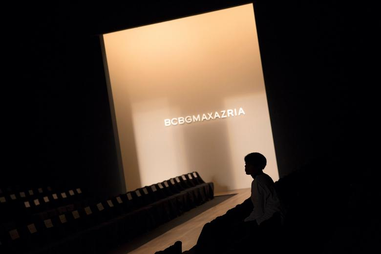 FILE PHOTO - A worker sits next to the runway before the BCBG Max Azria Fall 2015 collection show during New York Fashion Weekin New York, U.S. on February 12, 2015. REUTERS/Eric Thayer/File Photo