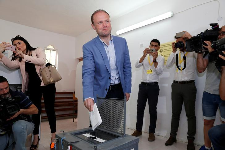 Prime Minister and Labour Party leader Joseph Muscat casts his vote during Malta's snap general elections in his home town of Burmarrad, Malta, June 3, 2017. REUTERS/Darrin Zammit Lupi