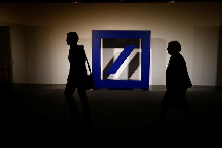 FILE PHOTO - The logo of Deutsche Bank is seen at its headquarters ahead of the bank's annual general meeting in Frankfurt, Germany May 18, 2017.  REUTERS/Ralph Orlowski