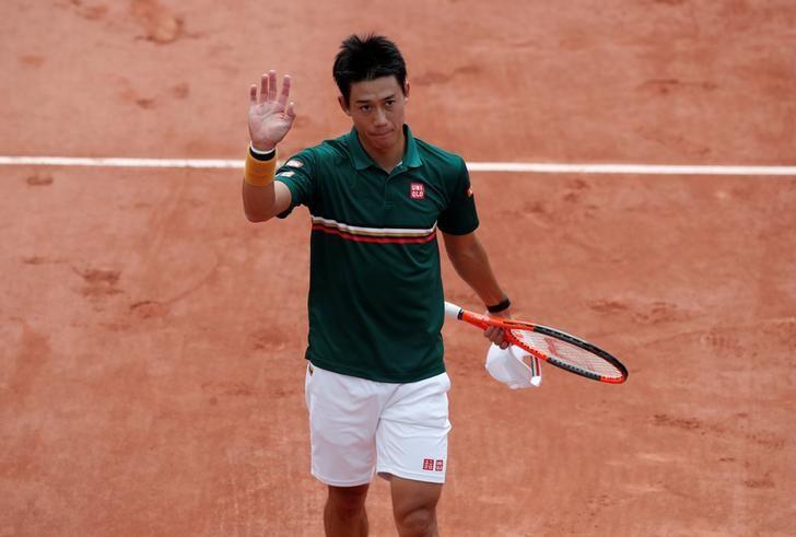 Tennis - French Open - Roland Garros, Paris, France - June 4, 2017   Japan's Kei Nishikori celebrates after winning his third round match against South Korea's Hyeon Chung   Reuters / Benoit Tessier