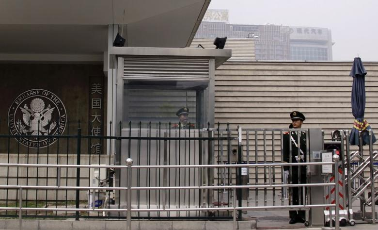 Paramilitary police officers guard the entrance to the U.S. embassy in Beijing April 30, 2012. REUTERS/Petar Kujundzic
