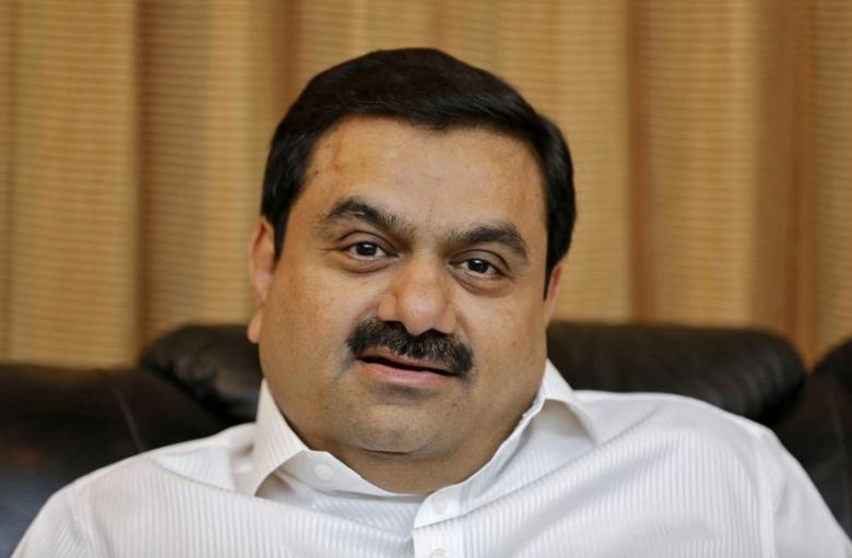FILE PHOTO: Indian billionaire Gautam Adani speaks during an interview with Reuters at his office in Ahmedabad, India, April 2, 2014. REUTERS/Amit Dave