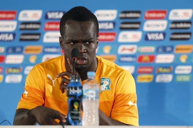 Ivory Coast's player Cheick Ismael Tiote answers questions during a news conference at the Mane Garrincha National Stadium in Brasilia, June 18, 2014.  REUTERS/Ueslei Marcelino/File Photo