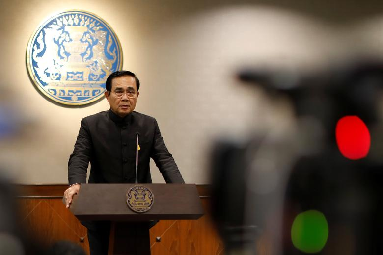 Thai Prime Minister Prayuth Chan-ocha attends a news conference as the junta marked the third anniversary of a military coup in Bangkok, Thailand May 23, 2017. REUTERS/Jorge Silva