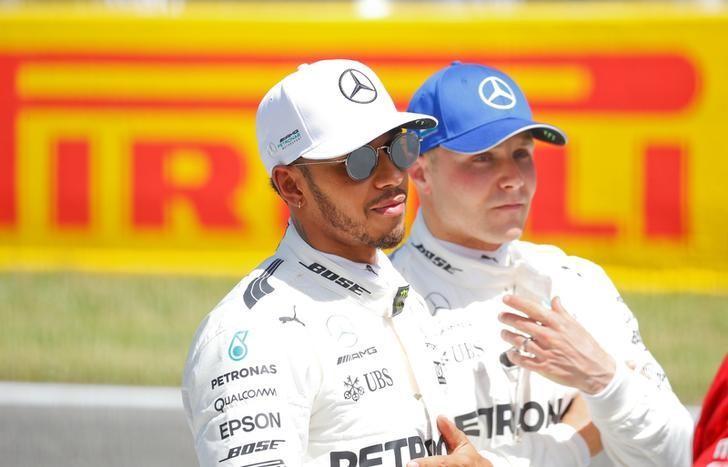 Formula One - F1 - Spanish Grand Prix - Barcelona-Catalunya racetrack, Montmelo Spain - 13/05/17 - Mercedes' Lewis Hamilton and Valtteri Bottas after the qualifying session. REUTERS/Juan Medina