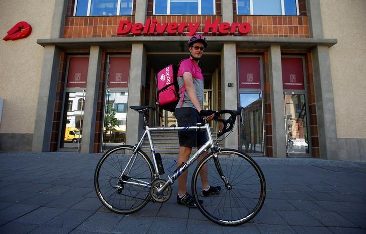 Andreas Harte, a Foodora delivery cyclist poses in front of Delivery Hero headquarters in Berlin, Germany, June 2, 2017. REUTERS/Fabrizio Bensch