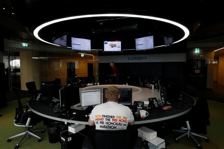FILE PHOTO: An employee works near screens in the virus lab at the headquarters of Russian cyber security company Kaspersky Labs in Moscow July 29, 2013. REUTERS/Sergei Karpukhin/File Photo
