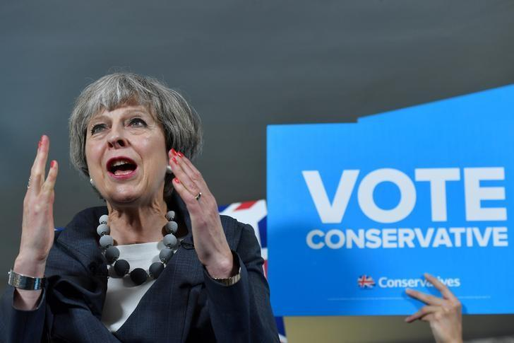Britain's Prime Minister Theresa May delivers a speech during an election campaign visit to Langton Rugby Club in Stoke-on-Trent, June 6, 2017. REUTERS/Ben Stansall/Pool
