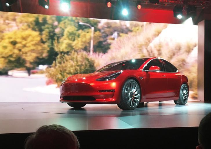 A Tesla Model 3 sedan, its first car aimed at the mass market, is displayed during its launch in Hawthorne, California, March 31, 2016.  REUTERS/Joe White/File Photo