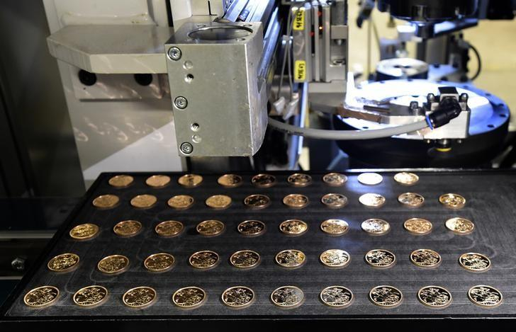 A tray of Bullion grade 2017 Sovereigns are seen at The Royal Mint, in Llantrisant, Wales, Britain, January 25, 2017. Picture taken January 25, 2017. REUTERS/Rebecca Naden/Files