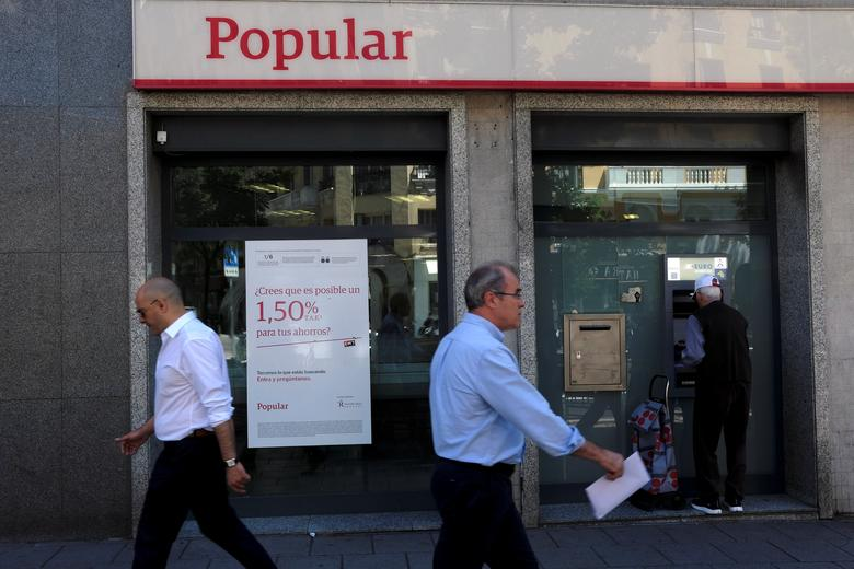 People walk past a Banco Popular branch in Madrid, Spain, June 6, 2017. REUTERS/Juan Medina