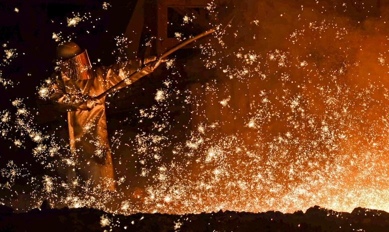 FILE PHOTO: A steel-worker is pictured at a furnace at the plant of German steel company Salzgitter AG in Salzgitter, Lower Saxony, Germany on March 17, 2015.  REUTERS/Fabian Bimmer/File Photo