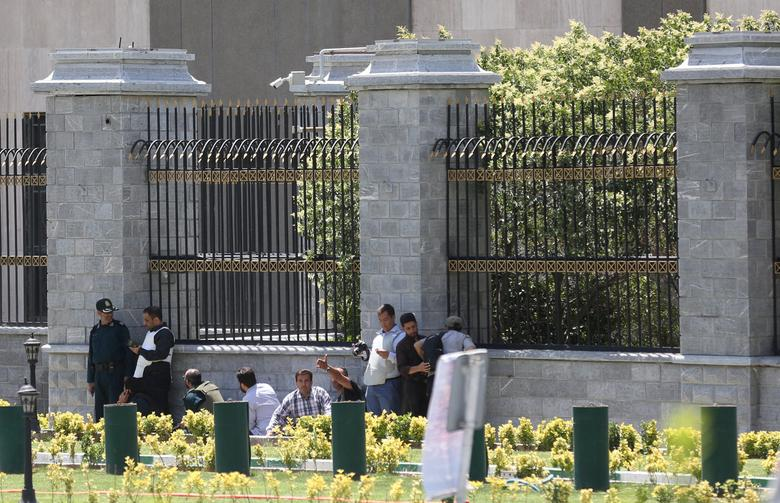 Members of Iranian forces and people take cover during a gunmen attack at the parliament's building in central Tehran, Iran, June 7, 2017. TIMA via REUTERS