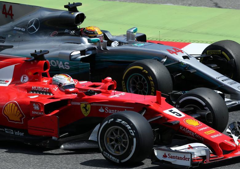 Formula One - F1 - Spanish Grand Prix - Barcelona-Catalunya racetrack, Montmelo Spain - 14/05/17 - Mercedes' Lewis Hamilton tries to overtake Ferrari's Sebastian Vettel. REUTERS/Albert Gea