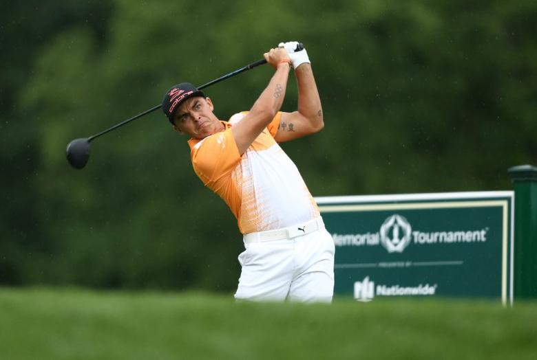 Jun 4, 2017; Dublin, OH, USA; Rickie Fowler tees off on the eighteenth hole during the final round of The Memorial Tournament golf tournament at Muirfield Village Golf Club. Mandatory Credit: Aaron Doster-USA TODAY Sports