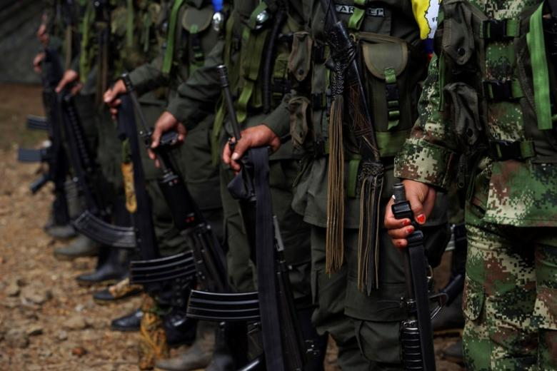 FARC members stand during a formation in a camp before moving to the transitional zone of Pueblo Nuevo, at the Los Robles FARC camp, Colombia, January 25, 2017. REUTERS/Federico Rios