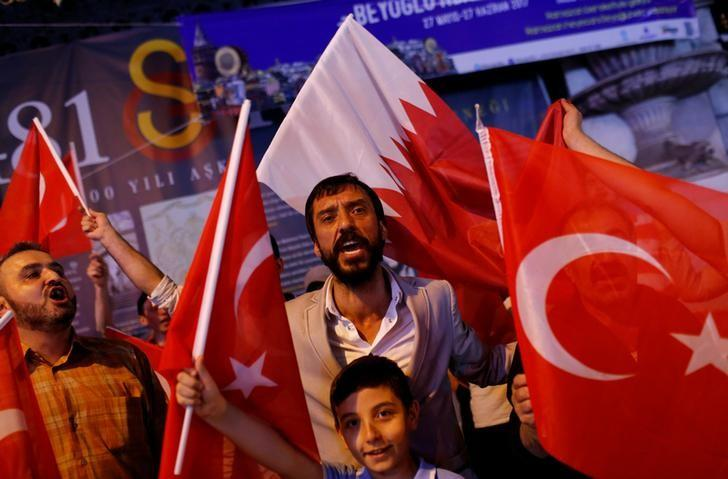 People shout slogans as they hold Turkish and Qatari flags during a demonstration in favour of Qatar in central Istanbul, Turkey, late June 7, 2017. REUTERS/Murad Sezer