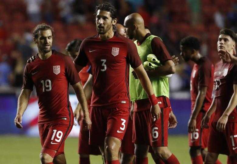 Jun 3, 2017; Sandy, UT, USA;  United States defender Graham Zusi (19) and defender Omar Gonzalez (3) get together after their 1-1 tie against Venezuela at Rio Tinto Stadium. Jeff Swinger-USA TODAY Sports
