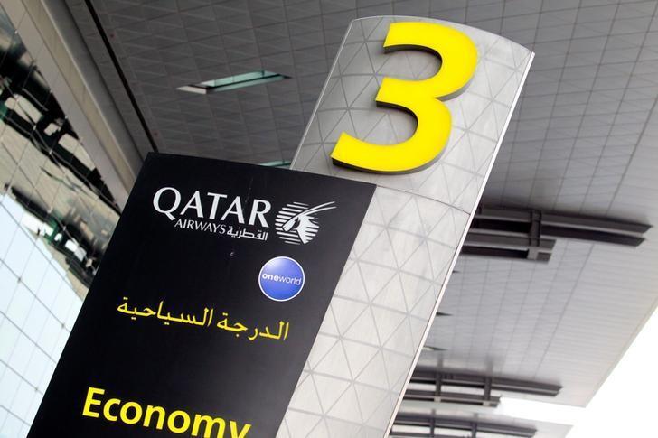 A sign of Qatar Airways is seen at Hamad International Airport in Doha, Qatar, June 7, 2017. REUTERS/Naseem Zeitoon