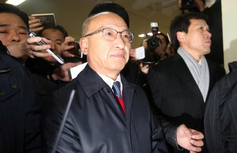 FILE PHOTO: The National Pension Service (NPS) Chairman Moon Hyung-pyo is summoned to the Independent Counsel Team in Seoul, South Korea, December 27, 2016. News1 via REUTERS/File Photo