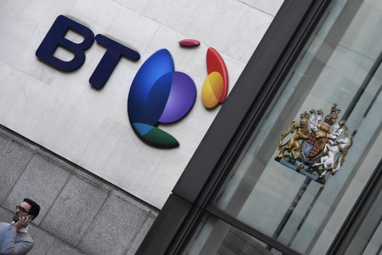 A man speaks on a mobile phone underneath a BT logo outside of offices in the City of London, Britain, January 24, 2017. REUTERS/Toby Melville