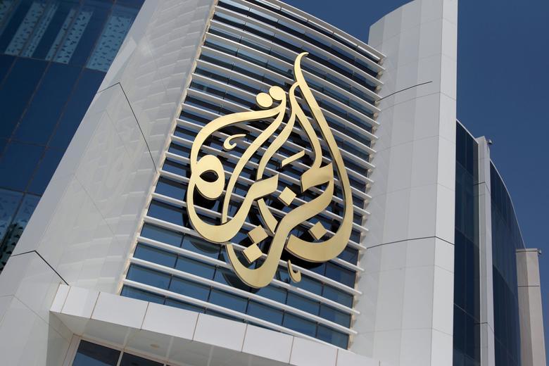 FILE PHOTO: The logo of Al Jazeera Media Network is seen on its headquarters building in Doha, Qatar June 8, 2017. REUTERS/Naseem Zeitoon/File Photo