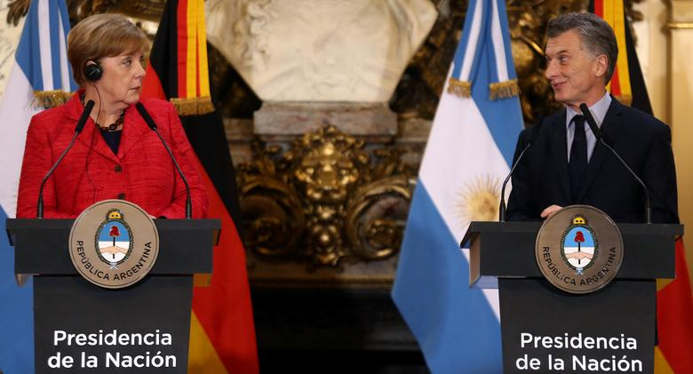 Germany's Chancellor Angela Merkel  and Argentina's President Mauricio Macri look at each other during a news conference at the Casa Rosada Presidential Palace in Buenos Aires, Argentina, June 8, 2017. REUTERS/Marcos Brindicci