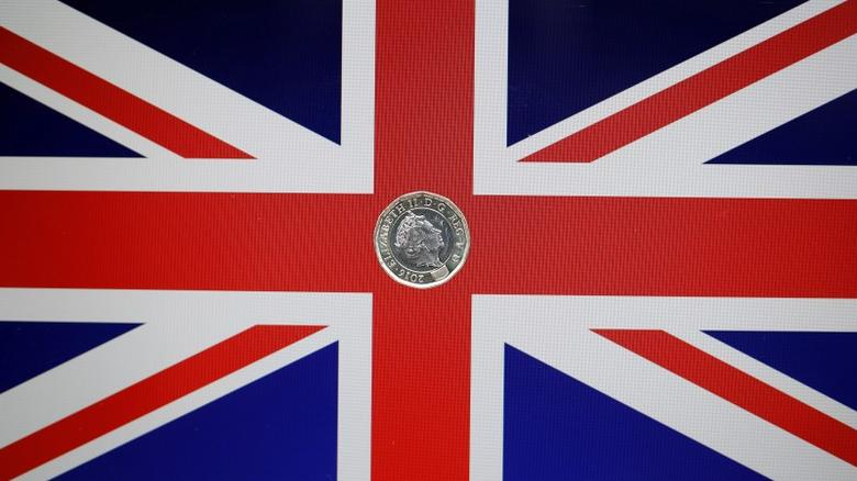 FILE PHOTO: A one pound coin lies on a Union Flag in a photo illustration shot May 3, 2017. REUTERS/Darren Staples/Illustration/File Photo