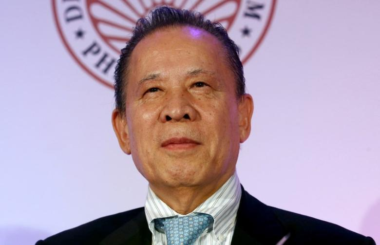FILE PHOTO --  Kazuo Okada, chairman of Tiger Resort, Leisure and Entertainment Inc. listens at the press launch of 65th annual Miss Universe competition on January 30, 2017 to be held in the Philippines, during a news conference in Makati city, Metro Manila, Philippines November 16, 2016.   REUTERS/Erik De Castro/File Photo