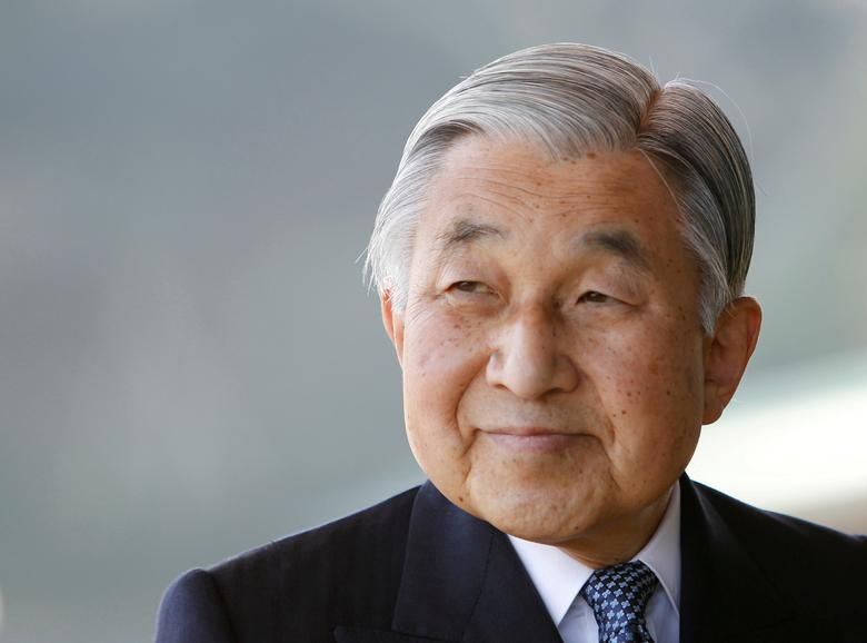 FILE PHOTO: Japan's Emperor Akihito smiles at the Imperial Palace in Tokyo February 23, 2011. REUTERS/Kim Kyung-Hoon/File Photo