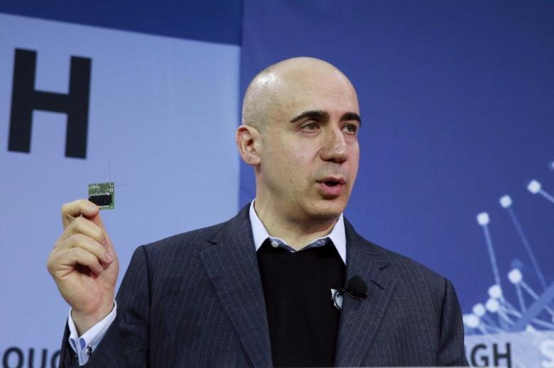 FILE PHOTO: Investor Yuri Milner holds a small chip during an announcement of the Breakthrough Starshot initiative in New York April 12, 2016. REUTERS/Lucas Jackson