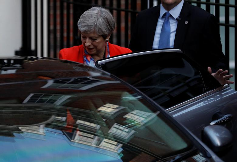 Britain's Prime Minister Theresa May leaves the Conservative Party's Headquarters after Britain's election in London, June 9, 2017. REUTERS/Peter Nicholls