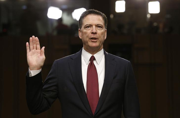 Former FBI Director James Comey is sworn in prior to testifying before a Senate Intelligence Committee hearing on Russia's alleged interference in the 2016 U.S. presidential election. REUTERS/Jonathan Ernst