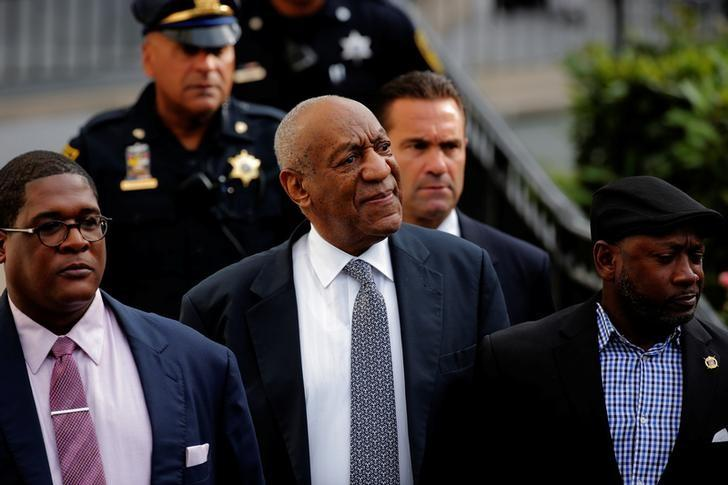 Actor and comedian Bill Cosby departs with comedian Joe Torry (R) and publicist Andrew Wyatt after the fourth day of Cosby's sexual assault trial at the Montgomery County Courthouse in Norristown, Pennsylvania, U.S., June 8, 2017.  REUTERS/Lucas Jackson