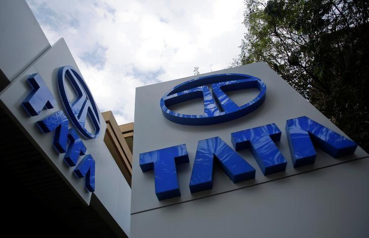 Tata Motors logos are seen at their flagship showroom before the announcement of their Q3 results in Mumbai February 14, 2013.  REUTERS/Vivek Prakash/File Photo