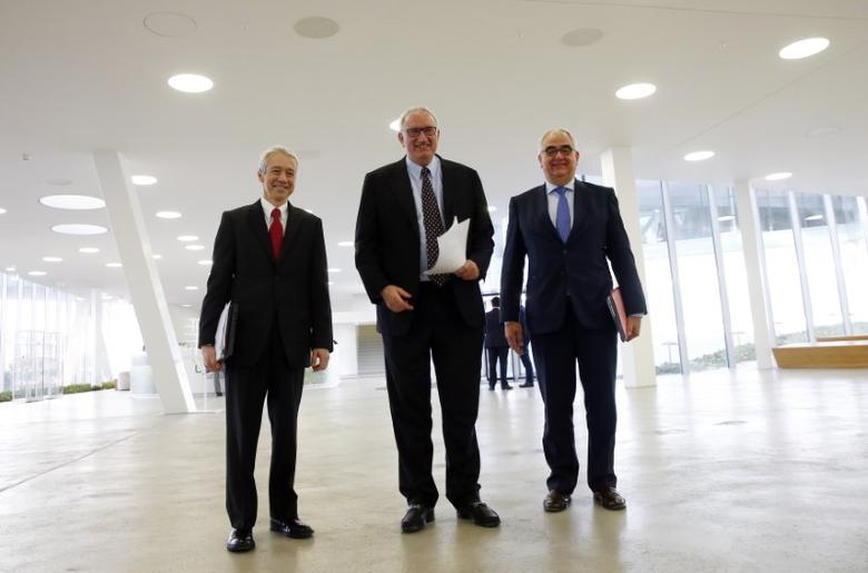 Johnson & Johnson Vice President and Worldwide Chairman Pharmaceuticals Joaquin Duato (L-R), Actelion CEO and founder Jean-Paul Clozel and Johnson & Johnson Chief Scientific Officer Pharmaceuticals Paul Stoffels pose for photographers at Actelion headquarters in Allschwil, Switzerland January 26, 2017. REUTERS/Arnd Wiegmann