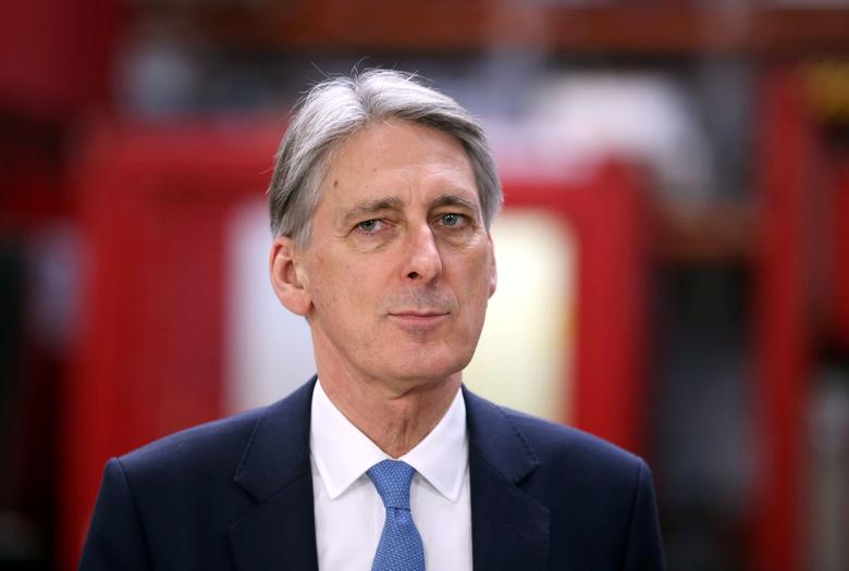 FILE PHOTO: Britain's Chancellor of the Exchequer Philip Hammond visits the Lyell Centre for Natural Environment Research, at Heriot-Watt University, Edinburgh, Scotland December 1, 2016. REUTERS/Jane Barlow/Pool/File Photo