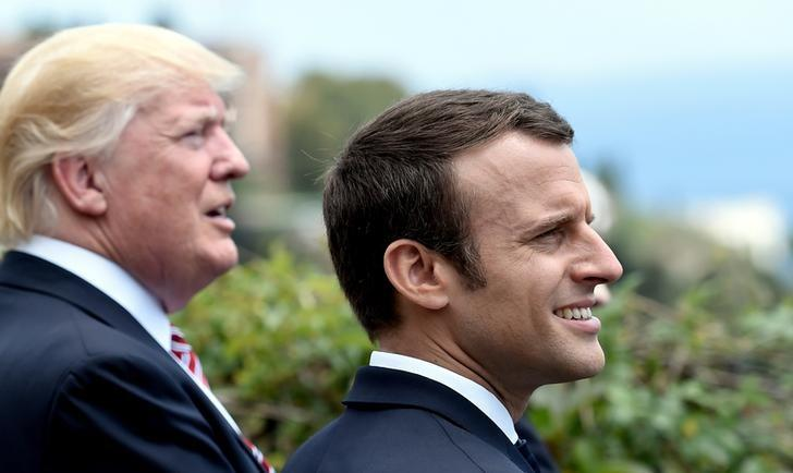 U.S. President Donald Trump (L) and French President Emmanuel Macron watch an Italian flying squadron as part of activities at the G7 Summit in Taormina, Sicily, Italy, May 26, 2017.  REUTERS/Stephane De Sakutin/Pool
