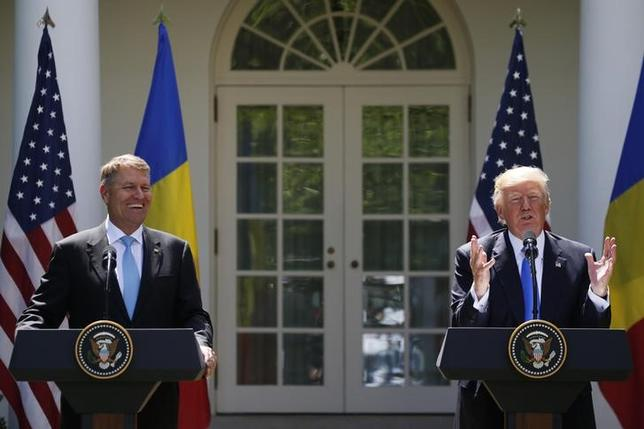 U.S. President Donald Trump (R) holds a joint news conference with Romanian President Klaus Iohannis in the Rose Garden at the White House in Washington, U.S. June 9, 2017.