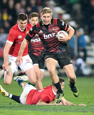 Rugby Union - British and Irish Lions v Crusaders AMI Stadium, Christchurch, New Zealand - 10/6/17 - Jack Goodhue of the Crusaders slips the tackle of Conor Murray of the Lions.   SNPA/Martin England/via REUTERS