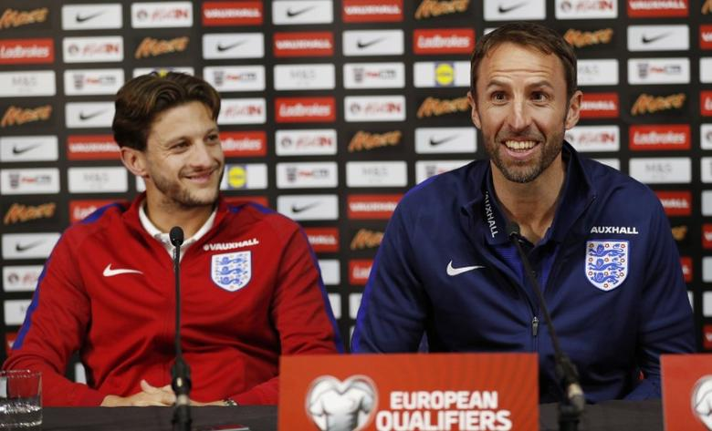 Britain Football Soccer - England Stadium Visit - Hampden Park, Glasgow, Scotland - June 9, 2017 England manager Gareth Southgate with Adam Lallana during a press conference Action Images via Reuters / Lee Smith Livepic