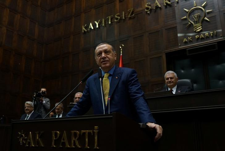 Turkish President Tayyip Erdogan addresses members of parliament from his ruling AK Party (AKP) during a meeting at the Turkish parliament in Ankara, Turkey, May 30, 2017. REUTERS/Umit Bektas/Files