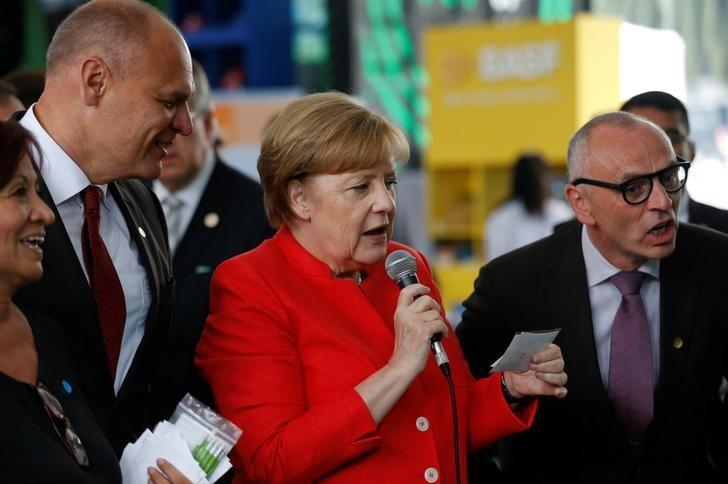 Germany's Chancellor Angela Merkel speaks to people at a pavilion during an event of the Dual Year Germany-Mexico, at the Revolution Monument in Mexico City, Mexico June 10, 2017. REUTERS/Henry Romero