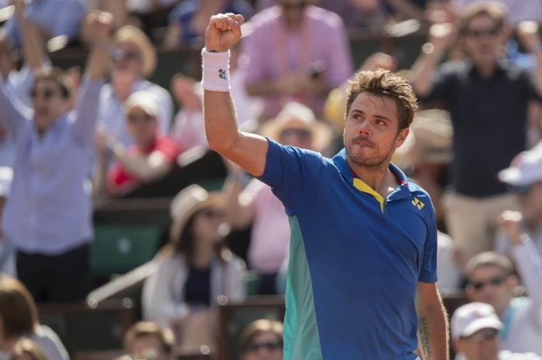 Jun 9, 2017; Paris, France; Stanislas Wawrinka (SUI) reacts during his match against Andy Murray (GBR) on day thirteen of the 2017 French Open tennis tournament at Stade Roland Garros. Mandatory Credit: Susan Mullane-USA TODAY Sports
