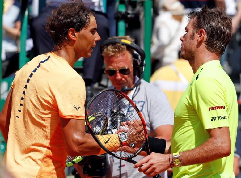 Tennis - Monte Carlo Masters - Monaco, 15/04/2016. Rafael Nadal of Spain (L) shakes hand with Stan Wawrinka of Switzerland following their match. REUTERS/Eric Gaillard  Picture Supplied by Action Images