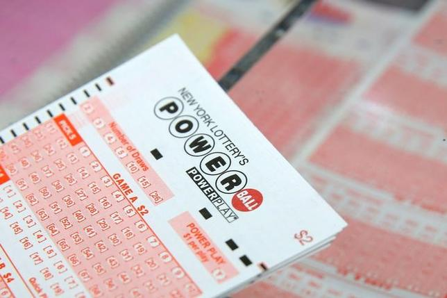 FILE PHOTO: A ticket for the U.S. lottery Powerball sits on a counter in a store on Kenmare Street in Manhattan, New York, U.S., February 22, 2017. REUTERS/Andrew Kelly/Files