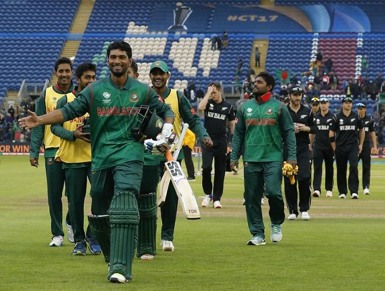 Britain Cricket - New Zealand v Bangladesh - 2017 ICC Champions Trophy Group A - Sophia Gardens - June 9, 2017 Bangladesh's Mohammad Mahmudullah leads his team off as he celebrates at the end Action Images via Reuters / Andrew Couldridge Livepic EDITORIAL USE ONLY.