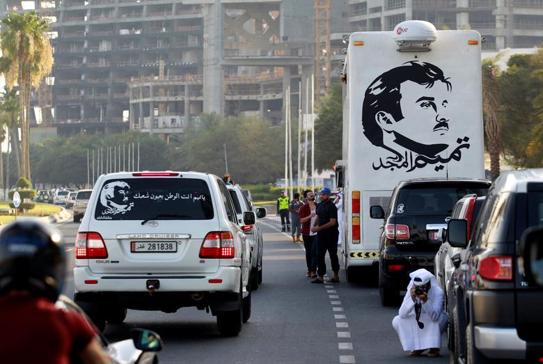 A painting depicting Qatar's Emir Sheikh Tamim Bin Hamad Al-Thani is seen on a bus during a demonstration in support of him in Doha, Qatar June 11, 2017. REUTERS/Naseem Zeitoon