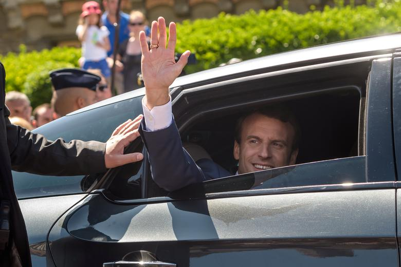 French President Emmanuel Macron waves from his car after voting in the first of two rounds of parliamentary elections in Le Touquet, France, June 11, 2017.    REUTERS/Christophe Petit Tesson/Pool